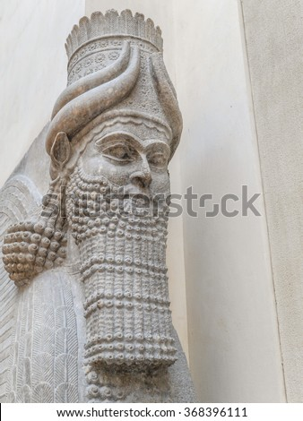PARIS, FRANCE - AUGUST 28 2013: - Closeup of Winged Assyrian Bull Head, Khorsabad, representing benevolent spiritual guardians part of Ancient Mesopotamian history exhibited in Louvre Museum - stock photo