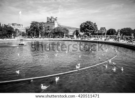 PARIS, FRANCE - AUGUST 30, 2015: Famous pound with fountains in park near the museum of Louvre on August 30 in Paris, France. - stock photo