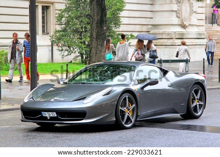 PARIS, FRANCE - AUGUST 8, 2014: Grey supercar Ferrari 458 Italia at the city street. - stock photo