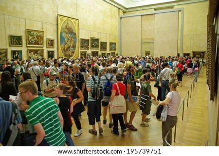 PARIS, FRANCE - AUGUST 03: Group of tourists gathered around the Mona Lisa in the Louvre Museum on August 03, 2008 in Paris, France. - stock photo