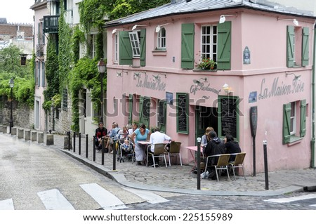 PARIS, FRANCE - August 20: Historical bistro on Montmartre - La Maison Rose - Pink House. Maurice Utrillo painted it around 1912, in Paris, France on August 20, 2014 - stock photo