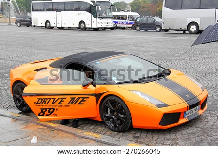 PARIS, FRANCE - AUGUST 8, 2014: Rental supercar Lamborghini Gallardo Spyder at the city street. - stock photo