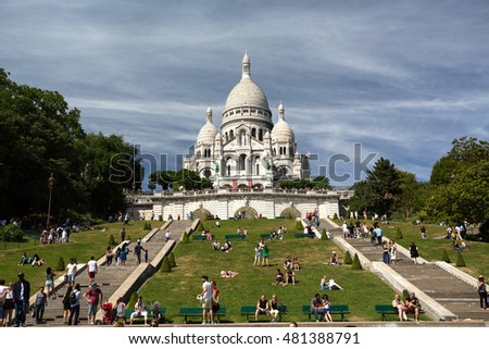 PARIS, FRANCE - AUGUST 14, 2016. Sacre Coeur Basilica in summer day. Large medieval cathedral. Basilica of Sacred Heart. Popular landmark, highest city point.