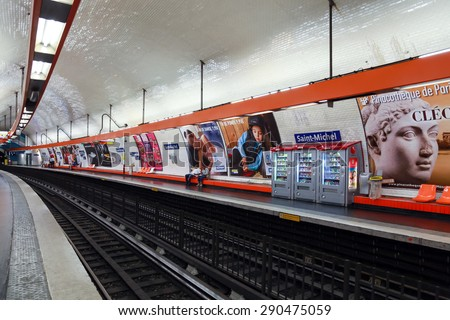 Paris, France - August 8, 2014: Saint-Michel. Parisian subway station with few passengers and advertising posters - stock photo