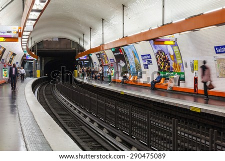 Paris, France - August 8, 2014: Saint-Michel. Parisian subway station with passengers and advertising posters - stock photo