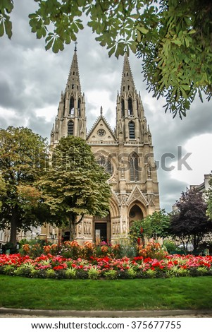 PARIS, FRANCE- AUGUST 19, 2014; Sainte-Clotilde Basilica, with its soaring symmetrical twin spires visible from many points all over Paris and its majestic Gothic facade,