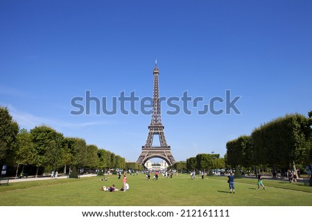 PARIS, FRANCE - AUGUST 5TH 2014: A view of the Eiffel Tower from Champ des Mars in Paris on 5th August 2014.