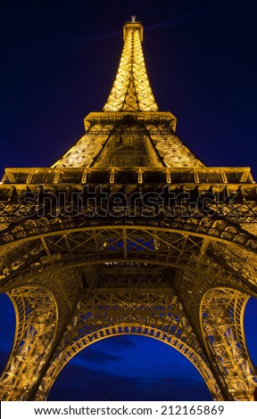 PARIS, FRANCE - AUGUST 9TH 2014: The magnificent Eiffel Tower at dusk in Paris on 9th August 2014. - stock photo