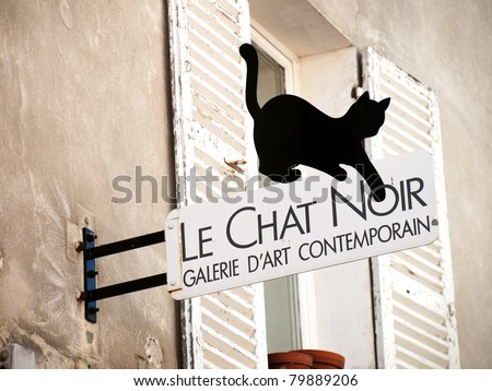 PARIS, FRANCE – AUGUST 16: The Black cat sign on art-gallery in Montmartre, Paris on August 16, 2009. Le Chat Noir is the famous poster sign of cabaret in the Montmartre. Now it became symbol of Paris