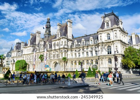PARIS, FRANCE - AUGUST 12, 2014: The City Hall in Paris. The area of Paris, where several centuries ago were carried public executions. It is one of the most popular tourist destinations in Europe. - stock photo
