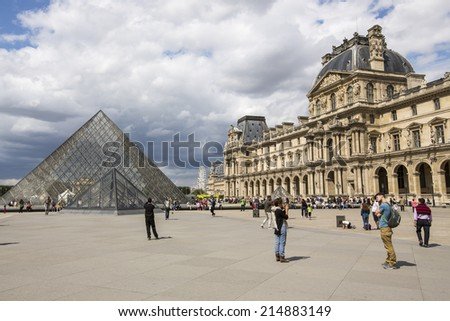 Paris, France - August 19: The Louvre Museum in Paris, France on August 19, 2014. This central landmark of Paris  is one of the world's largest museums. - stock photo