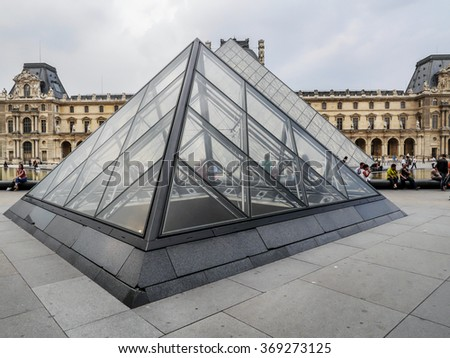 PARIS, FRANCE - AUGUST 28 2013: - The main courtyard of the Louvre Museum with the glass Pyramid - stock photo