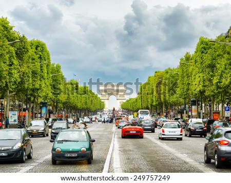 PARIS, FRANCE - AUGUST 13, 2014: The Triumphal arch to the Champs-Elysees. The avenue is one of the most famous streets in the world for upscale shopping and popular tourist attraction of Paris. - stock photo