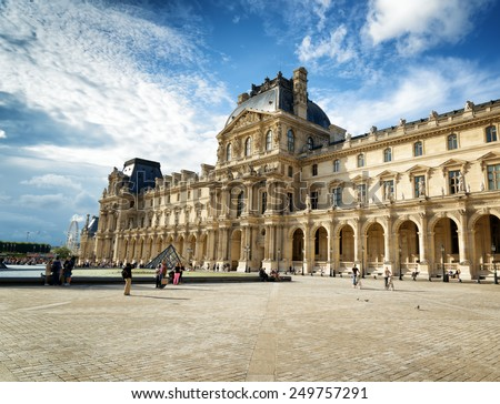 PARIS, FRANCE - AUGUST 13, 2014: The view of the Passage Richelieu, which is part of the Louvre, from the court of Napoleon. In this wing exhibited the royal crowns and the throne of Napoleon. - stock photo