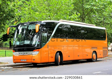 PARIS, FRANCE - AUGUST 8, 2014: Touristic coach Setra S415HD at the city street. - stock photo
