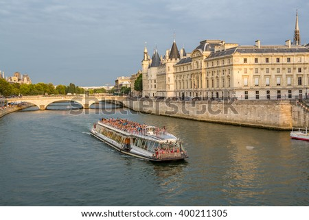 PARIS, FRANCE-AUGUST 8- Tourists pack river barge for sunset cruise in Paris, France on Aug 8, 2015 - stock photo