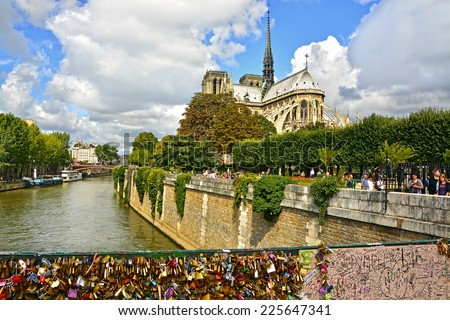 PARIS, FRANCE - August 18, 2014: View from Notre Dame de Paris, Seine River and Pont des Arts (Passarelle des Arts) with many locks symbolize love for ever. - stock photo