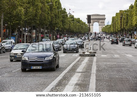 Paris, France - August 17: View of the Arc de Triomphe de l'Etoile in Paris, France on August 17, 2014. The Triumphal Arch honours those who fought and died for France.
