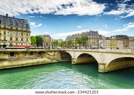 "PARIS, FRANCE - AUGUST 12, 2014: View of the Bridge Saint-Michel. The bridge over the River Seine is mentioned in the novel by Victor Hugo, ""Notre Dame de Paris"". - stock photo"