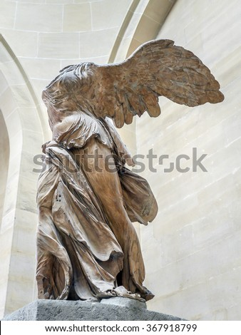 PARIS, FRANCE - AUGUST 28 2013: Winged Victory of Samothrace, also called Nike of Samothrace, marble sculpture exhibited in Louvre Museum  - stock photo