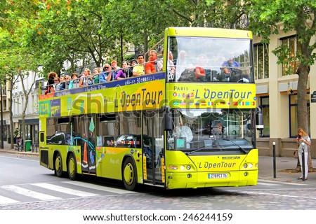 PARIS, FRANCE - AUGUST 8, 2014: Yellow city sightseeing bus Neoplan N4426/3 Centroliner at the city street. - stock photo