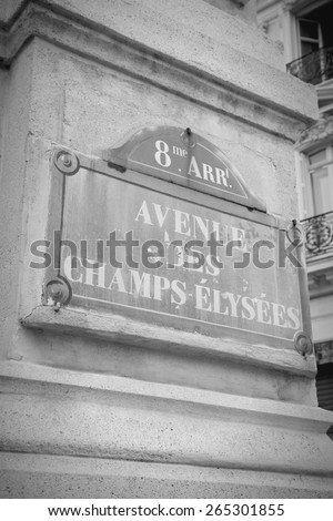 Paris, France - Champs Elysees street sign. One of the most famous streets in the world. Black and white toned photo. - stock photo