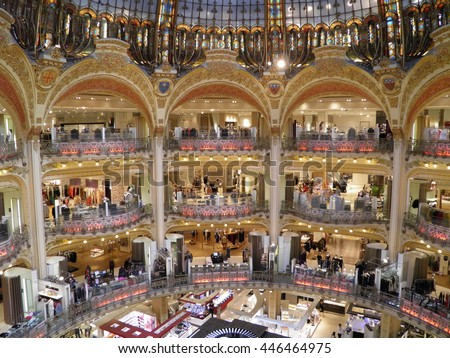 PARIS, FRANCE - CIRCA AUGUST 2011: La Fayette shopping centre with its dramatic architecture is one of the most popular tourist attractions in Paris - stock photo