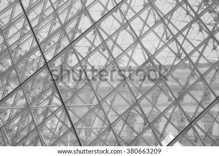 PARIS, FRANCE - CIRCA JUNE 2007: The Musee du Louvre meaning Louvre museum in black and white - stock photo