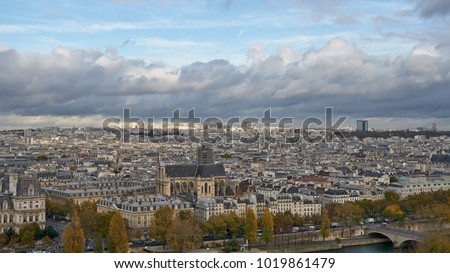 Paris, France. Cityscape. Panoramic view from the top of the Notre Dame cathedral. Cloudy sky.