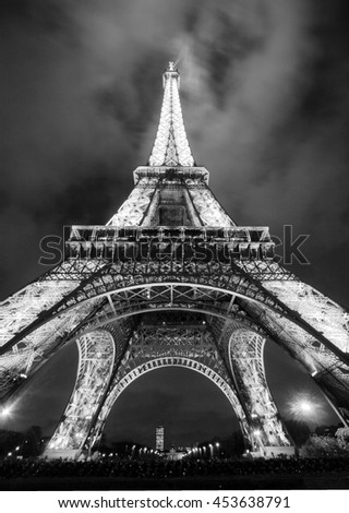 PARIS, FRANCE - DEC 16 2005: Ceremonial lighting of the Eiffel tower  2006 in Paris, France. The Eiffel tower is the most visited monument of France. - stock photo