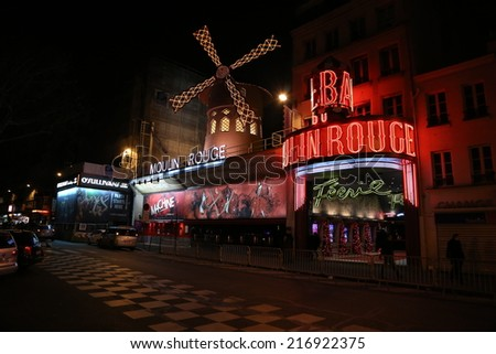 Paris, France - Dec, 31: the Moulin Rouge by night, on December, 31, 2013 in Paris, France. Moulin Rouge is a famous cabaret built in 1889, locating in the Paris red-light district of Pigalle - stock photo