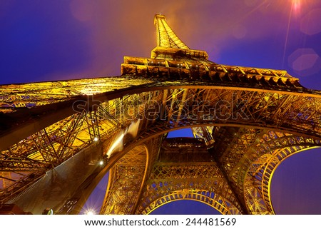 PARIS, FRANCE - DECEMBER 25: Ceremonial lighting of the Eiffel tower on DECEMBER 25, 2014 in Paris, France. The Eiffel tower is the most visited monument of France.