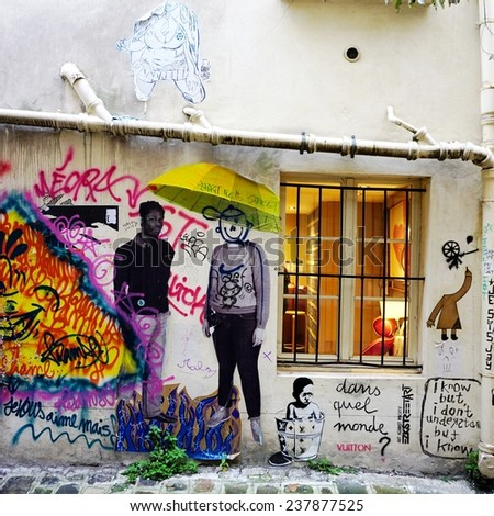 PARIS, FRANCE --6 DECEMBER 2014-- Colorful graffiti art line the street walls and back alleys of the French capital.