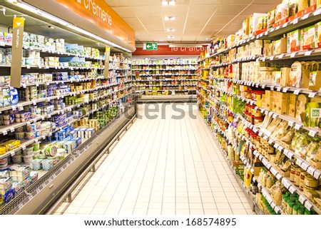 PARIS, FRANCE - DECEMBER 17 : inside of the parisian Carrefour supermarket - one of the cheapest retailers originated in France and one of the biggest world hypermarket chains on December 17th, 2012 - stock photo