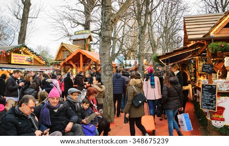 PARIS, FRANCE - DECEMBER 6, 2015: People at traditional Christmas food market at Avenue des Champs-Elysees .