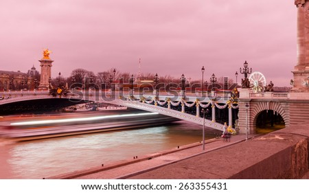 Paris, France - December 22, 2014: Pont Alexandre 3, named after the Russian Tsar Alexander. The famous and popular place for walking and recreation. - stock photo