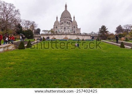 Paris, France - December 19 ,2014: Sacre Coeur on Montmartre, one of the most famous attractions of Paris. Montmartre hill, one of the highest points in Paris. - stock photo