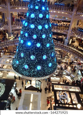 PARIS, FRANCE - DECEMBER 8: Swarovski christmas tree at the famous Galeries Lafayette department store on the Boulevard Haussmann on December 8, 2012