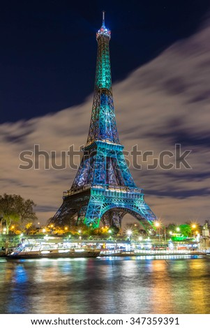 Paris; France-December 02, 2015: The Eiffel tower covered by a green visual forest as part of the organization of the Conference on climate COP 21 that gathers 193 countries in Paris , France. - stock photo