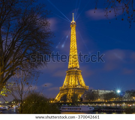 Paris, France-December 09, 2015 : The Eiffel tower is a historical monument, one of the most visited in the world, located on the bank of Seine river in Paris, France. - stock photo