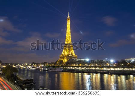 Paris, France-December 09, 2015: The Eiffel tower is a wrought lattice tower on the Champs de Mars in Paris.The tower is the tallest structure in Paris and the most visited monument in the world.