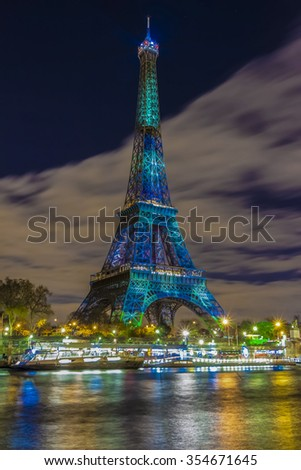 Paris; France-December 02; 2015: The Eiffel tower lit up in green as a part of the organization of of the conference on climate change COP 21.this conference gathers 193 countries in Paris. - stock photo