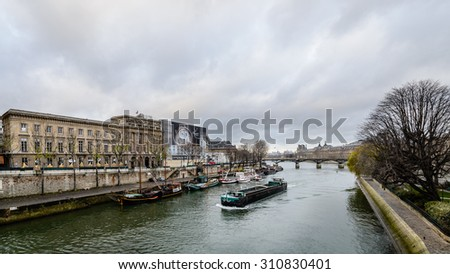 Paris, France - December 23: The Seine river, the main watercourse that flows through the city of Paris, France. Photograph shot on December 23, 2013