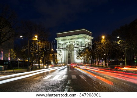 Paris; France-December 06; 2015 ; The Triumphal Arch is one of the most famous monument in Paris.It stands in the center of the Place Charles de Gaule, at the western end of the Champs Elysees .