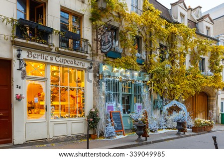 Paris, France - December 19, 2015: Typical Parisian cafes decorated for Christmas in the heart of Paris. Christmas is one of the main Catholic holidays, which is celebrated on a large scale throughout - stock photo