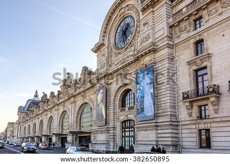 PARIS, FRANCE - DECEMBER 31, 2014: View of D'Orsay Museum. D'Orsay - a museum on left bank of Seine, it is housed in former Gare d'Orsay. Orsay holds mainly French art dating from 1848 to 1915. Sunset - stock photo