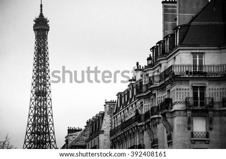 PARIS, FRANCE - DECEMBER 7, 2014: Wide angle view of the Eiffel Tower in Paris, during winter.  The world famous Eiffel Tower is the main landmark of Paris - stock photo