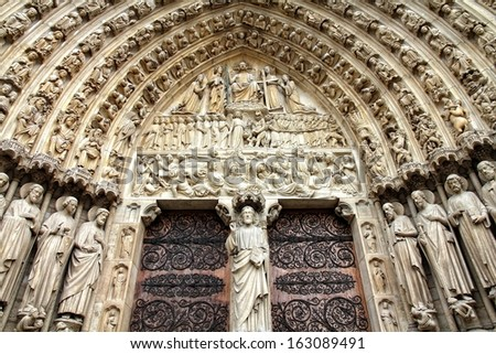 Paris, France - famous Notre Dame cathedral facade saint statues. UNESCO World Heritage Site.