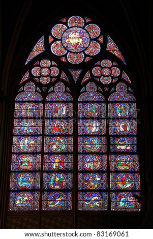 Paris, France - famous Notre Dame cathedral stained glass. UNESCO World Heritage Site. - stock photo