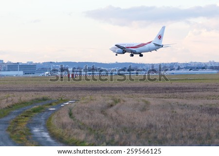 PARIS, FRANCE - FEBRUARY 21, 2015: Air Algerie Airline Boeing 737-6D6 lands at ORLY Airport (ORY). Air Algerie is Algeria's flag carrier. - stock photo